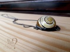 Real snail shell resin pendant. Grove snail by IsThisHandmade #snail #shell #pendant #handmade #necklace
