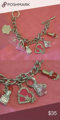 "Juicy Couture rare charms, heart opens, look! Beautiful Juicy Couture silver tone charm bracelet loaded with charms.   Red enamel shoe charm with crystals on the toe, a large ""diamond "" ring, a punk enamel heart charm with crystals and a bow that Opens to reveal crystals, lipstick charm,  pink purse charm, a pink heart w/ a crown that says Juicy & a white charm that says ""Choose juicy"".  Some of the charms show some wear. Please see pics! Some of these charms are selling for more than the…"