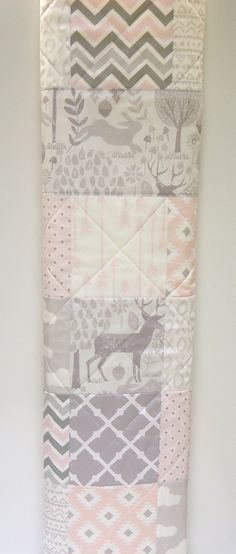 Baby Girl Quilt, Pink and Gray Woodland Quilt. This baby girl quilt is precious, with it's baby pink and soft light grays. A classic color combination that is one of my favorites. I've constructed and quilted this quilt in a newer modern style sure to please new mothers! The batting used is warm and natural, all cotton, a batting that allows for this type of quilting. The quilt back is a very soft and light colored solik cream/white flannel. This quilt will shrink and it's always best to...