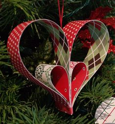 """These paper stripe heart ornaments are all crazy easy. And you can't get cheaper than paper, so they're perfect for a """"disposable"""" application like changing a color scheme year to year, or decorating a wedding tree. You can use them as a Valentine's day decoration or a gift topper."""