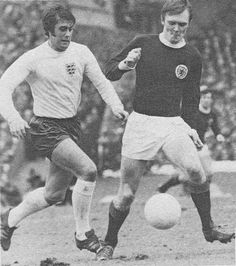 25th April 1969. England centre forward Geoff Hurst chasing down Scotland's David Hay in the Home International, at Hampden Park