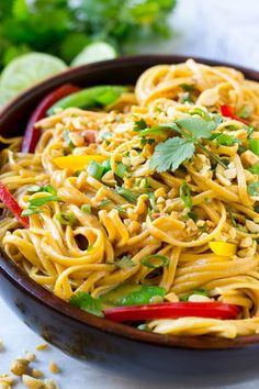 This recipe for Thai peanut noodles is full of colorful veggies & tossed in an easy homemade peanut sauce. No need for take out when you can make your own!