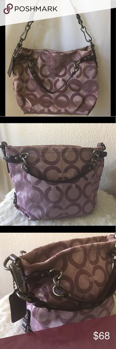 """COACH Op Art Signature Sateen Brooke Bag 14147 Coach Brooke Sateen Op Art Bag, Style No 14147 *Genuine Leather Trim *Detachable 21"""" Leather Strap has 8"""" Drop *Two Leather Handles *Oversized Leather Coach Hangtag *Zip-Top Closure *Interior Lined with Satin Fabric *Interior Zippered Pocket *Two Interior Multi-Function Slip Pockets Good used condition with minor fraying at top, see last pic. Coach Bags"""