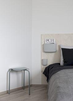 Simple diy headboard: Normann Copenhagen´s Pockets + plywood board.