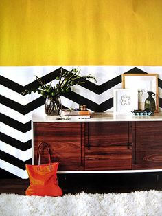 Chevron stripes, beautiful console, and perfect shade of mustard yellow [unknown source] Bold Wallpaper, Geometric Wallpaper, Love Your Home, Just Dream, Dining Room Walls, Apartment Living, Dream Apartment, Wall Treatments, Elle Decor