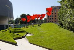 """The MAXXI museum has a new colorful courtyard. Winners of the MoMA/P.S.1 Young Architects Program,  the Italian firm stARTT's courtyard, called """"Whatami"""" incorporates a series of faux-nature around the museums architecture."""