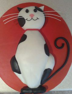 black and white cat cake                                                                                                                                                                                 More