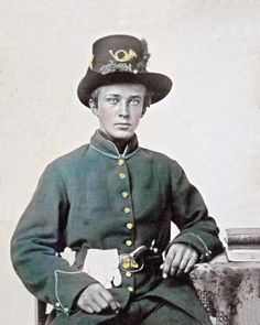 Young soldier wearing Hardee hat and gun tucked in belt.