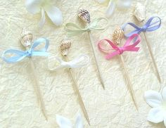 Seashell Toothpicks (100 per pack) , http://www.amazon.com/dp/B003KPAP3E/ref=cm_sw_r_pi_dp_e0tHrb15D90RP