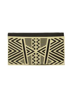 NUMBER SIX - handmade, laser cut aztec brass motif plate, riveted onto black leather.  features nude leather lining.