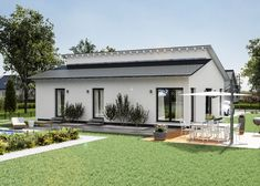 Inexpensive bungalow with pent roof by massa haus Bungalows, House Roof, Construction, Exterior, House Design, Architecture, Outdoor Decor, Home Decor, Lifestyle