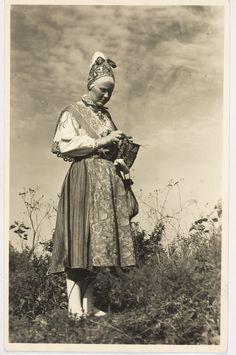 "Esonia Museum artifact; ""Naine sukka kudumas"" - knitting just bytheway. Beloved crafting on Island of Kihnu, Estonia"
