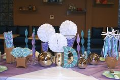 Our Mermaid & Shark Party was awash in teal, blue, purple, pink, silver and white. Candy and candles in our colors accented the table.