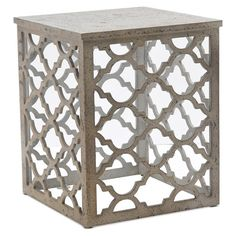 Square end table in distressed white with an openwork quatrefoil base.  Product: End tableConstruction Material: