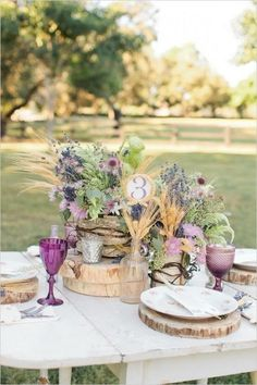 rustic lavender and wheat wedding centerpieces / http://www.deerpearlflowers.com/wheat-wedding-decor-ideas/