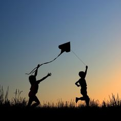 #Silhouette# children at play with their kite.