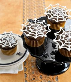 Super-easy white-chocolate toppers appear to float, Houdini-like, over chocolate cupcakes. These are perfect decorations for halloween cupcakes.
