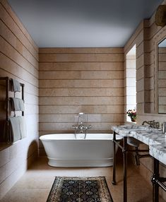 A luxury bathroom with a soaking tub, limestone walls and floors and a marble vanity in an NYC triplex, designed by Alexander Gorlin Architects. French Bathroom, Small Bathroom, Master Bathroom, Bathroom Towels, Spanish Style Bathrooms, Manhattan Penthouse, Limestone Wall, Bathroom Styling, Architectural Digest