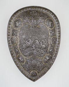 Shield of Henry II of France //  The battle scene at the center depicts the victory of Hannibal and the Carthaginians over the Romans at Cannae in 216 B.C., an allusion to the struggle of France against the armies of the Holy Roman Empire during the sixteenth century.