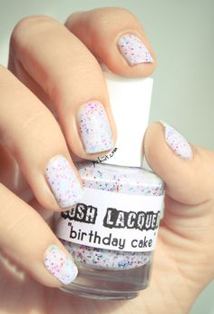 I think I might want this crazy white glitter nail polish... LUSH LACQUER Birthday Cake