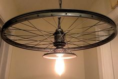 We created this bike rim chandelier from the rear wheel of a vintage bike. (24 diameter) It also includes various vintage light fixtures and lamp                                                                                                                                                      More