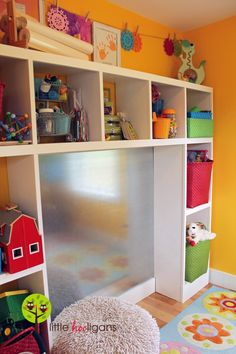 playroom wall made of aluminum so it can be used as a dry wipe and magnetic board
