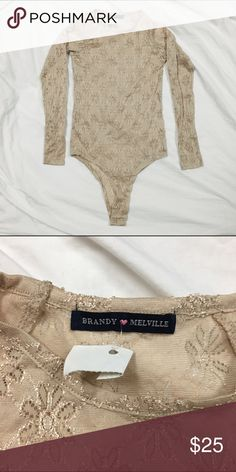 NWT Nude Lace Body Suit Leotard NWT Brandy Melville Nude Floral Lace Long Sleeve Body Suit  One Size-- (fits more like a XS, Small, or Medium)-- a little stretchy  ❗️Price Firm. No Trades.❗️ Brandy Melville Tops