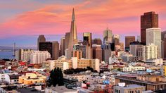 San Francisco sunset skyline in California with reflection in bay water USA Hotels San Francisco, San Francisco Skyline, San Diego, San Fransisco, Real Estate News, Estate Homes, City Lights, Home Buying, Sunset