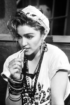 80s Madonna rocking stacked bracelets & necklaces