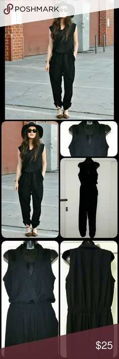 """*Forever 21* V-neck Pantsuit Black sleeveless v-neck pantsuit w/ front pockets. Other details include collar, 2 breast pockets, tapered hem and 1"""" elastic waist. V-neck has inside snap.  Approximately 53"""" in length. Top-to-waist is 17"""", elastic band is 1"""", band-to-bottom is 35"""". 100% Polyester Forever 21 Pants Jumpsuits & Rompers"""