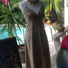 """Taupe Colored Tank Dress 👗👀 Taupe Mid Calf length (on my 5'2"""" frame) 100% cotton tank dress made in Peru. Size small, but with elastic stretch back might fit medium size as well. Never worn. Super cute! Dresses"""