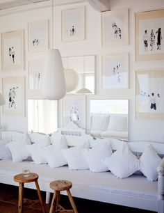 white matted frames, black and white picture wall