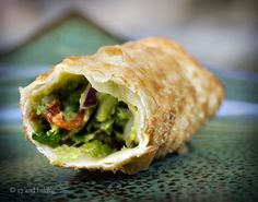 Avocado and sundried tomato eggrolls with chili dipping sauce