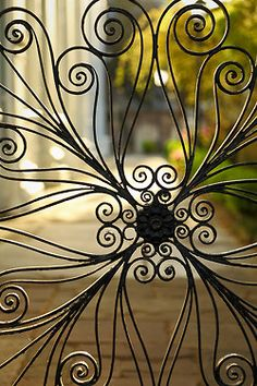 This is a detail of one of the most famous decorative wrought iron works in Charleston, Saint Michael's Churchyard gate.