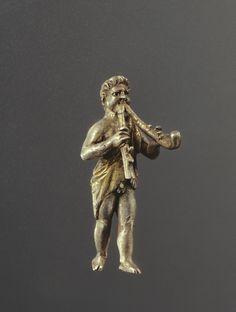 Statuette of a Young Satyr Playing the Double Aulos; Unknown; Roman Empire; 150 - 200; Silver with gilding.