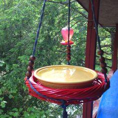 homemade bird bath = flat basket + pie plate + plant hanger! take a bath you smelly birdy!!