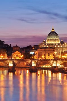 Just a few minutes' walk from the hotel is the Tiber - and a classic view of St Peter's dome. #Jetsetter