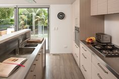 An upstand on the island ensures all kitchen clutter remains out of sight of the living areas.