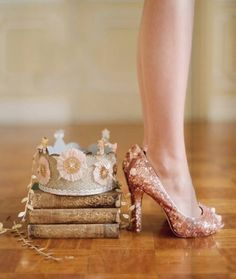 The shoes, the paper crown, the books. Perfect.