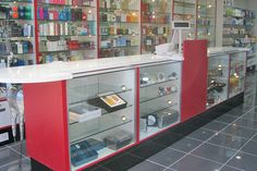 Pharmacy dispensary design and over the counter shelving and storage solutions. Showroom Design, Shop Interior Design, Shop Counter Design, Mobile Shop Design, Wooden Sofa Set Designs, Stationary Shop, Store Layout, Retail Store Design, Boutique Interior