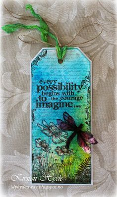 A tag made with dylusions spray and Tim Holtz stamp. Made by Kirsten Hyde