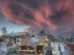 Oia, Santorini sunset | Sunset over Oia, Santorini, Greece Photographic Print by Darrell Gulin ...