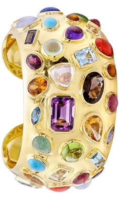 "{Seaman Schepps ""50's"" Gem-Set Cuff Bracelet} ""50's"" cuff bracelet in 18k yellow gold with multicolored gemstones, including amethyst, tourmaline, citrine, turquoise, lapis, peridot, topaz and carnelian. Numbered and signed by Seaman Schepps. {ht}"