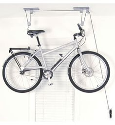 Raise and store your bike or other bulky items up and out of the way in the garage or basement with a Ceiling Hoist Bike Rack. This sturdy garage storage hoist easily lifts and stores a bicycle kayak or ladder and helps maximize available floor space for parking vehicles. Bike hoist has a 50 pound weight capacity.C