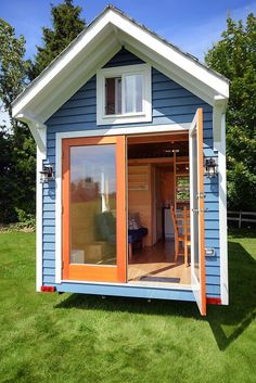 Tiny 160 sq ft blue house with double doors and plenty of high-quality features. For sale in Canada. | Tiny Homes