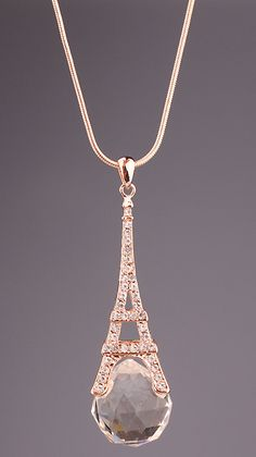 Gold Diamond Eiffel Tower Necklace that Tobias gives Tris. Chapter 56