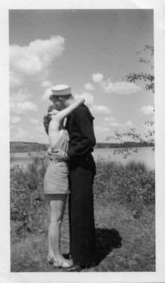 1940s •~• WWII sailor and his gal, black and white photograph