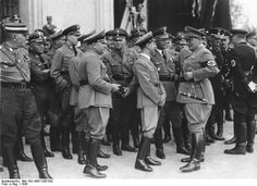 Nuremberg Rally 1936. Hermann Göring is talking with Joseph Goebbels and Franz Xaver Schwarz. To the left of Goebbels is Robert Ley, who along with Göring, would be charged at the Nuremberg War Crimes Trials with crimes against humanity.