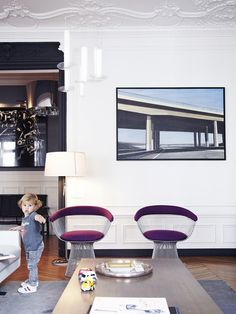 · Source: The Socialite Family Those Platner chairs...