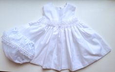 A personal favourite from my Etsy shop https://www.etsy.com/uk/listing/262041570/white-sparkle-baby-girl-dress-special